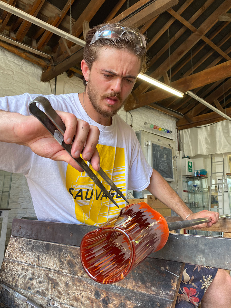 Sacha Delabre blowing Ian Chadwick design vessel at The Glass Hub